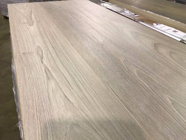 pallet of euro style oyster teak 12mm wide plank laminate flooring