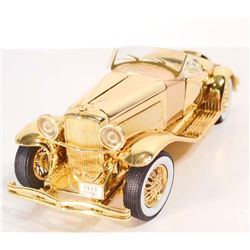 GOLD MODEL TOY CAR OF A 1935 DUESENBERG SSJ