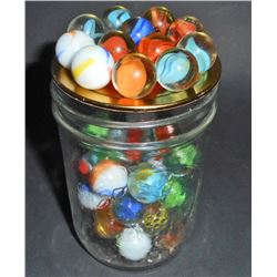 SMALL JAR OF VINTAGE MARBLES