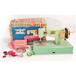 VINTAGE C 1950S CASIGE PRESSED STEEL CHILDS SEWING MACHINE W/ ORIG BOX