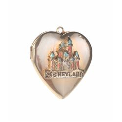 Sleeping Beauty Castle Heart-Shaped Locket.