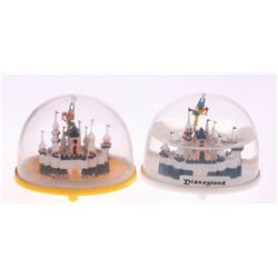 Pair of (2) Sleeping Beauty Castle Snow Globes.