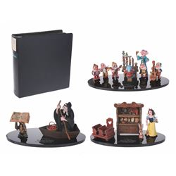 """Set of (14) """"Snow White's Scary Adventures"""" Attraction Models and Model Shop Binder."""