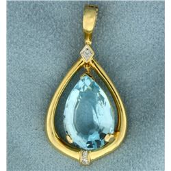 12 ct Blue Topaz and Diamond Pendant