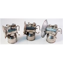 "Three Different ""Trademark"" Justrite Carbide Lamps"