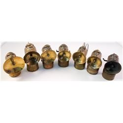 Seven Early Brass Justrite Carbide Lamps