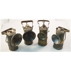 Four Superintendent-style Carbide Lamps
