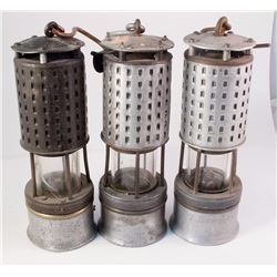 Three Mining Safety Lamps
