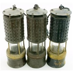 Three Early Brass Safety Lamps