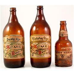 Three Acme Beer Bottles