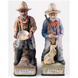 Pair of Gold Miner Ceramic Whiskey Containers