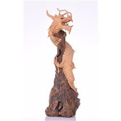 Dragon Sculpture Wrapped Around Driftwood.  Es