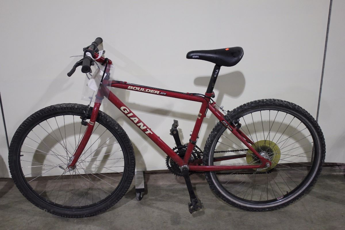 2 bikes: red giant mountain bike & red schwinn hybrid bike