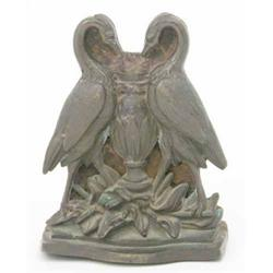 A Victorian bronze door stop, cast as a pair of storks flanking an urn, cast iron back, damages 8...