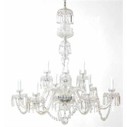 A good 20th century glass two tier twelve branch chandelier, with fluted scroll branches and cut...