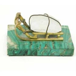 A 19th Century Russian ormolu and rock crystal model of an ice sledge, on a malachite plinth, 5 i...