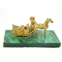 A 19th century Russian ormolu group of a horse drawn sleigh and driver, on malachite plinth, 10.7...
