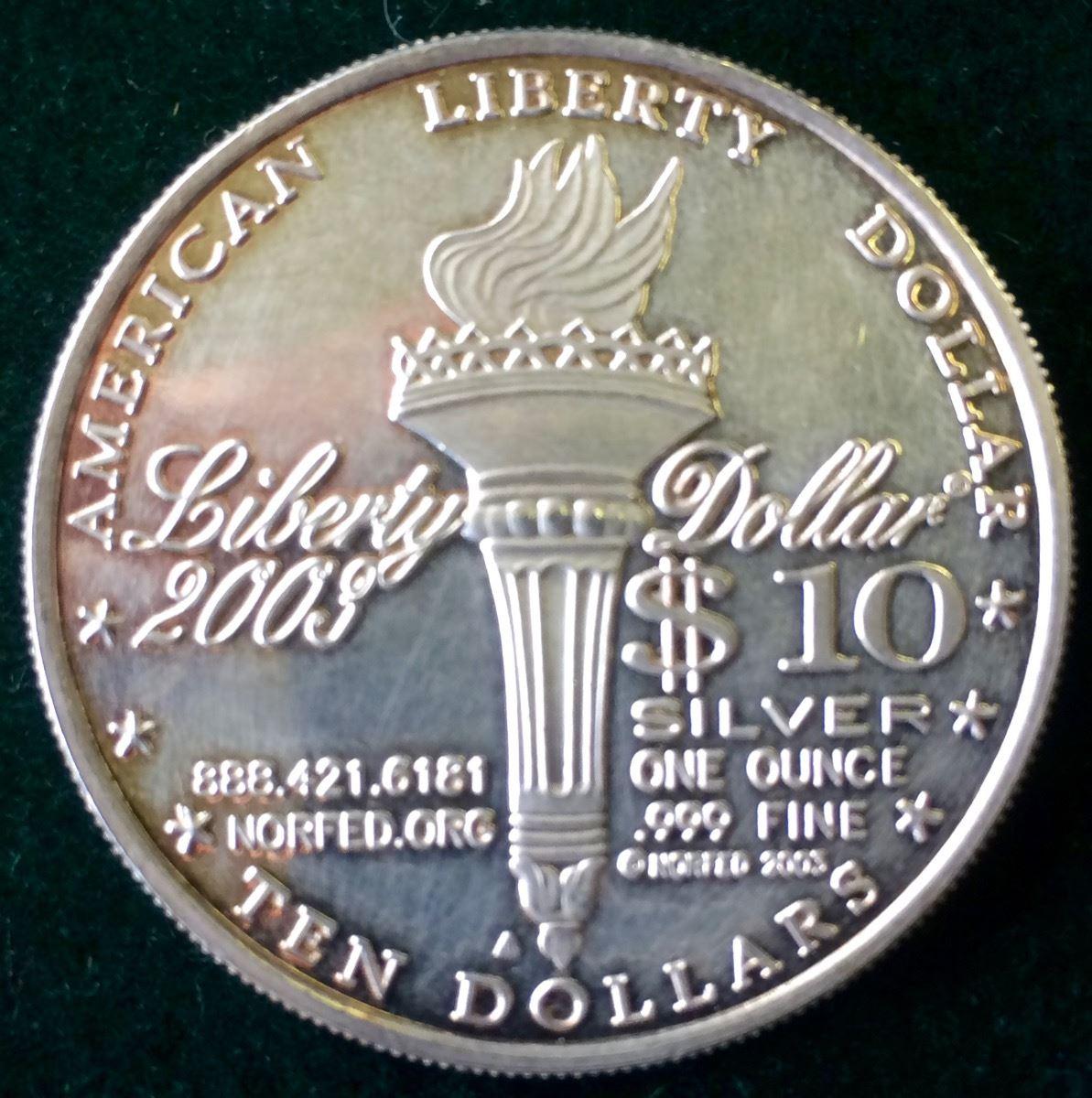 1 oz fine silver one dollar 2003