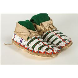 "Northern Plains Beaded Child's Moccasins. 6 ¼"" long with fully beaded uppers."