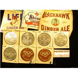 Group of (7) 1980-84 Olympic Games Medals & (6) Different Beverage Bottle Labels from years ago.