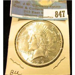 1922 D U.S. Peace Silver Dollar, Brilliant Uncirculated.