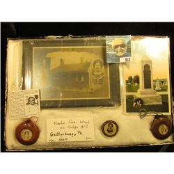 Gettysburg, Pennsylvania Civil War Memorabilia in a glass frame. Includes (2) Wooden Canteens made f
