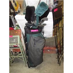 Golf bag containing assorted clubs