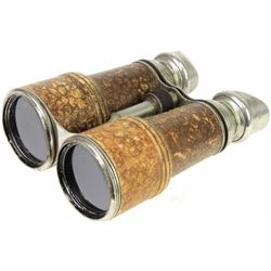 Vintage binoculars, leather covered with nickel on metal parts, overall good condition.