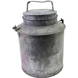 Galvanized Railroad water can with handle intact, stamped CMSTP & PRR, shows overall good condition.