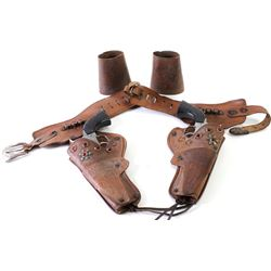 """Lot of 2 includes Matt Dillion double cap gun rig and childs cuffs. Rig says """"Gunsmoke"""" on belt and"""