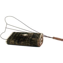 Collection of 2 Homestead items includes rug beater and Clark foot or bed warmer.
