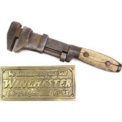 """Collection of 2 Winchester items includes No. 1003 monkey wrench 10"""" long and brass Winchester cartr"""