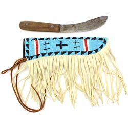 Contemporary beaded knife sheath with early trade knife.