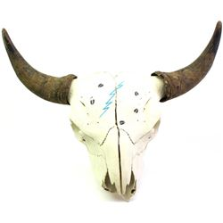 """Hand painted buffalo skull unsigned with horn caps intact, 24"""" tip to tip."""