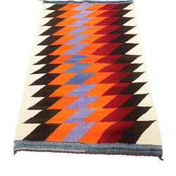 Navajo regional rug with serrated diamond pattern, horizontal strips top and bottom, remains good to