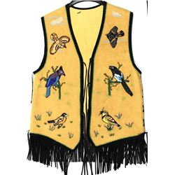 Contemporary beaded vest on tanned elk, beadwork nicely accomplished, depicts reptiles, birds and an