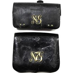 Collection of 2 civil war era leather cartridge pouches.