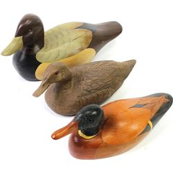 Collection of 3 contemporary duck decoys the smallest marked Howard Doll Chapel Hill NC.