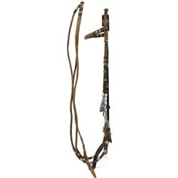 Finely braided rawhide headstall and reins fitted with unmarked loose jaw bit.