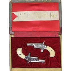 Cased set of 2 Colt No. 4 .22 cal. SN 14769N / 14768N with nickel finish, faux ivory grips one right