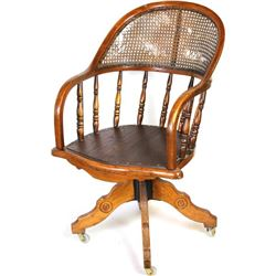 Antique oak office chair bentwood arms with turned spindles and caned back showing some damage, good