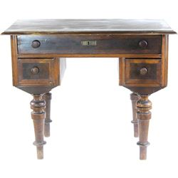 Napoleon style mahogany writing desk 19th C. with center drawer over left and right drawers all on t