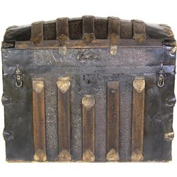 Antique hump back trunk with embossed floral panels, leather handles missing otherwise very nice, 18