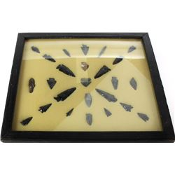 """Framed collection of various arrowheads and points, some incomplete and showing repair, framed 13"""" X"""