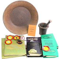 Misc. collection of Homestake Mining items includes safety award, books, gold pan, mortar with pesta