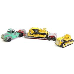 Collection of 3 vintage Tootsie toys includes truck and low boy and 2) caterpiller crawlers.