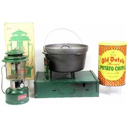 Collection of 4 includes vintage Coleman camp lantern, camp stove, contemporary dutch oven and Old D