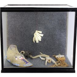 """Shadow box collection includes 1890's Northern Plains single moccasin, 11"""" X 15"""" X 17"""" ."""