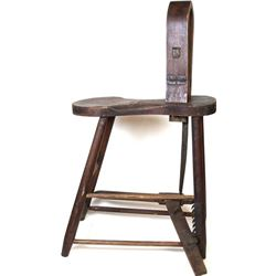 Early saddle makers stitching horse with interesting diamond Key brand carved into top.