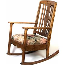 Good antique oak rocking chair with upholstered and padded seat, solid with good finish.